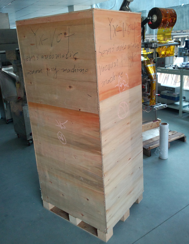 filling machine in wooden case.jpg