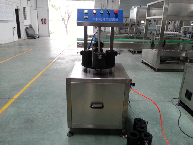 vacuum capper in factory.jpg