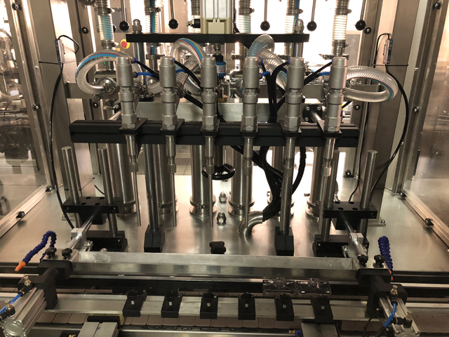 perfume filling line fully automatic.JPG