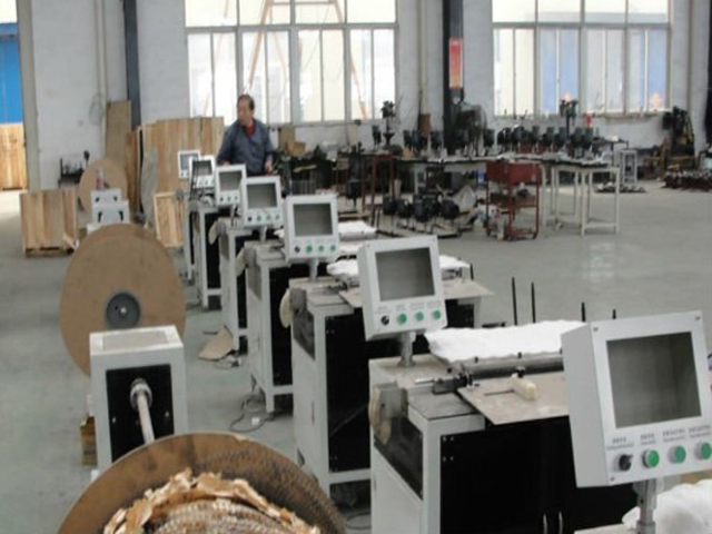 In factory for binding equipment.jpg