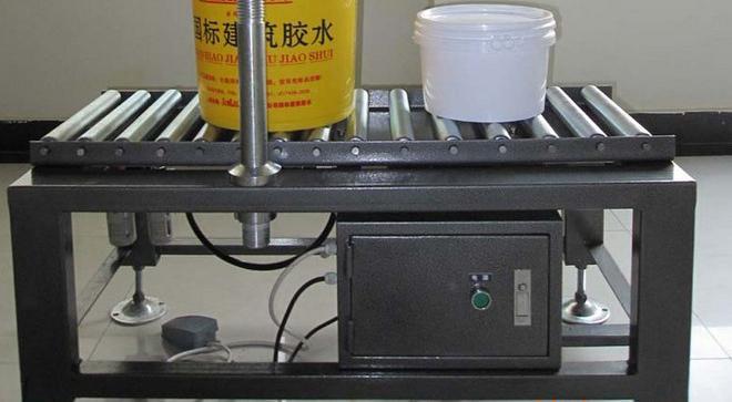 close picture of press capper.jpg