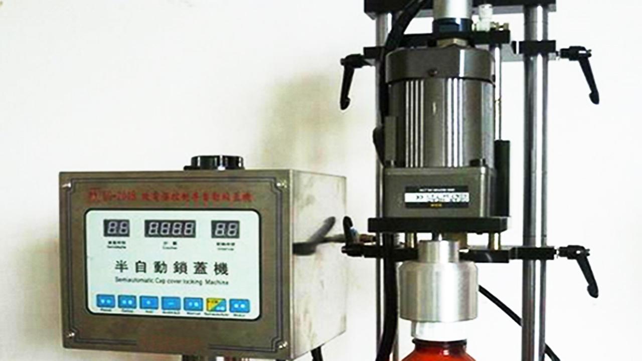 press capper equipment.jpg