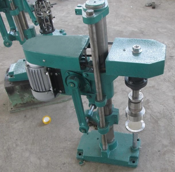 metal cap locking machine.jpg