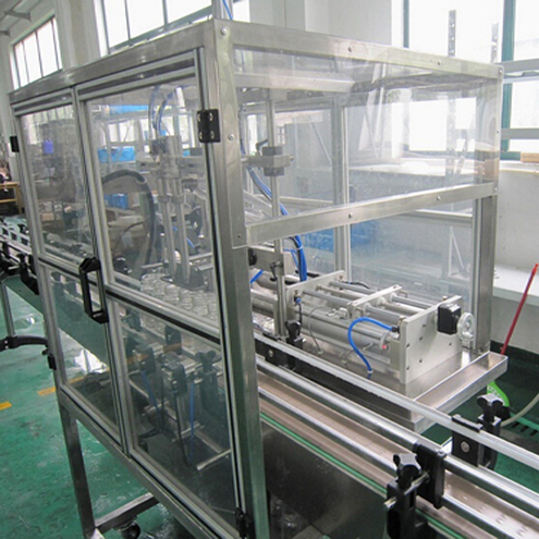 coconut oil automatic filling lines bottles turntable UV sterilizer glass jars  2 heads pneumatic filling manual feeding capping vertical roundbottles labeller machinery