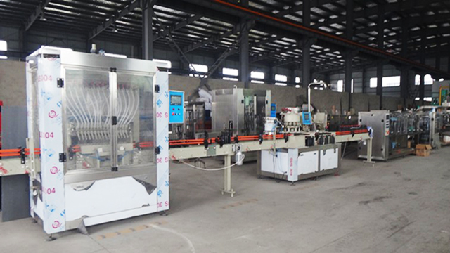 machine filling capping gravity filler.jpg