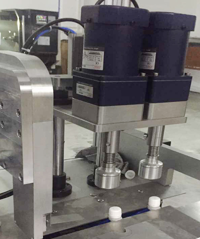 two capping heads.jpg