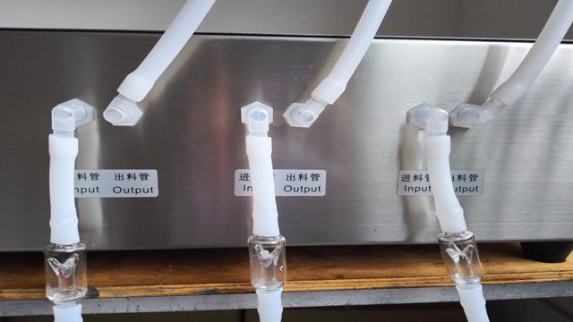 three heads filling machinery tubes.jpg
