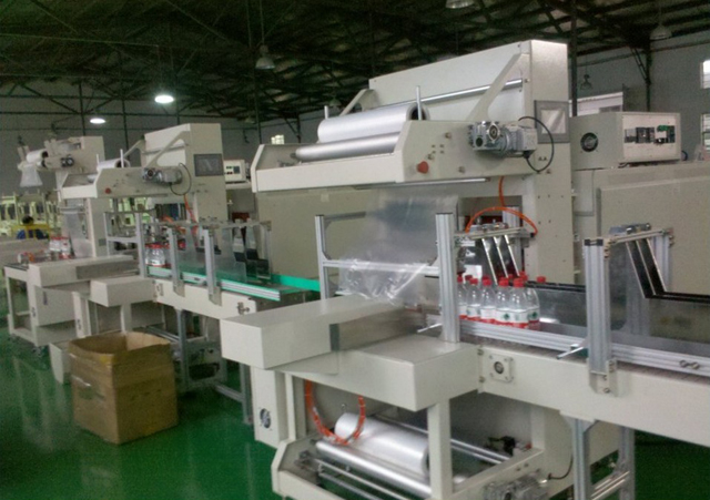 the machines used in factory shrink packing.jpg