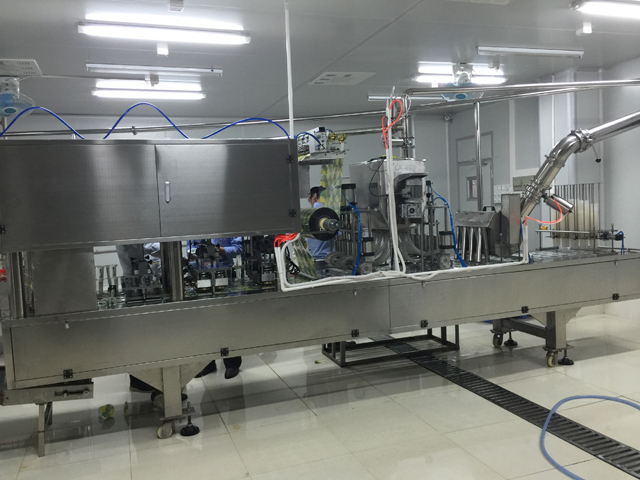 cups filling sealing machine.jpg