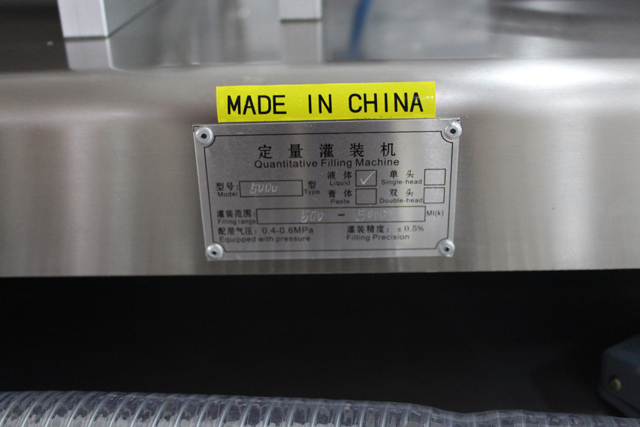 double filling nozzles filling machine.jpg