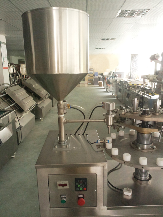 tubes filler sealer hopper.jpg