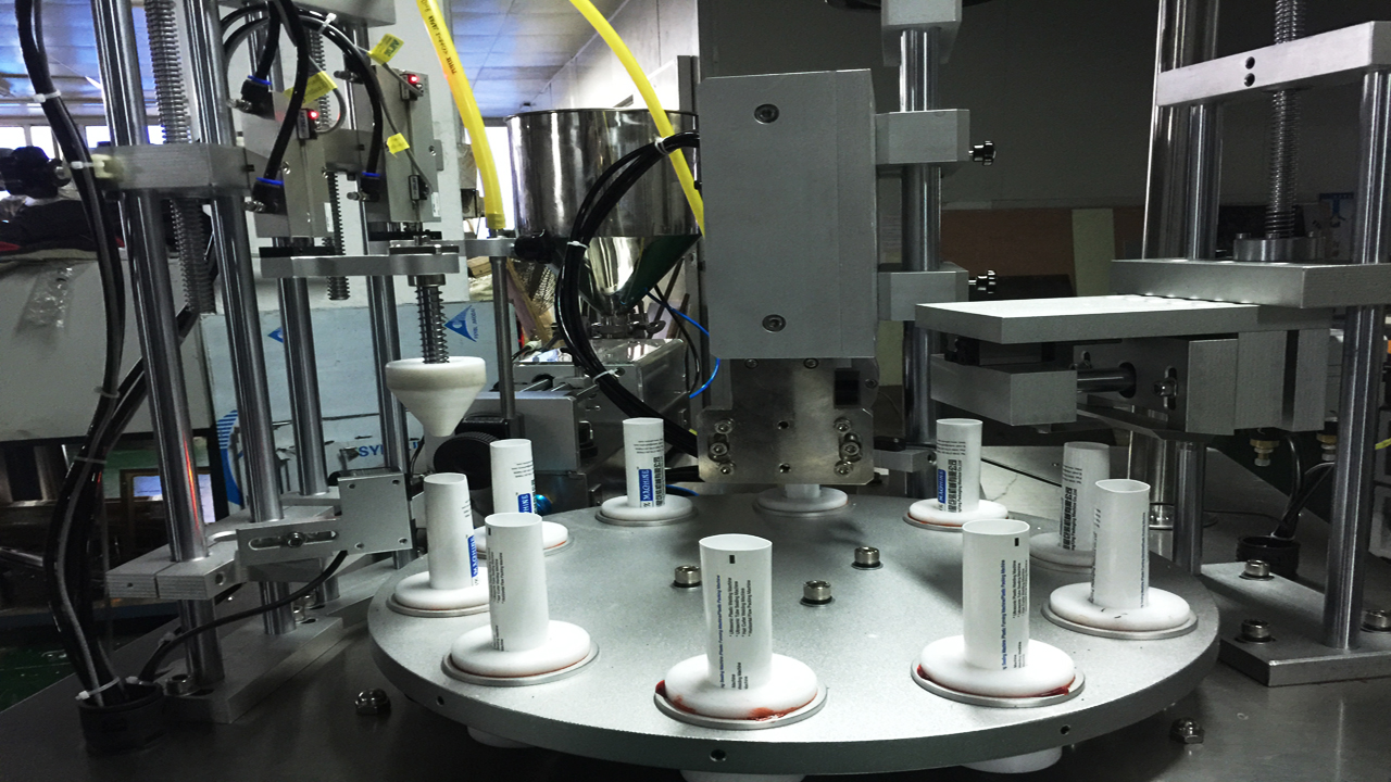 rotary filling ultrasonic tubes sealing.jpg