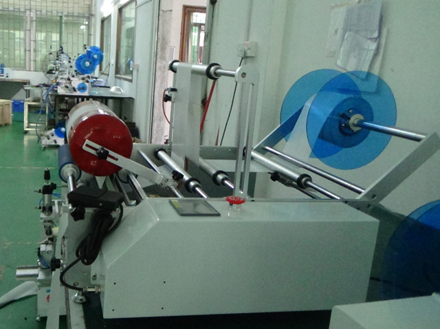 fire extinguisher labeller equipment semi automatic.jpg