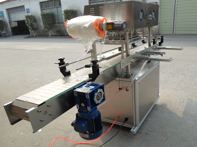 model YX-FS30A jars sealing machine.jpg