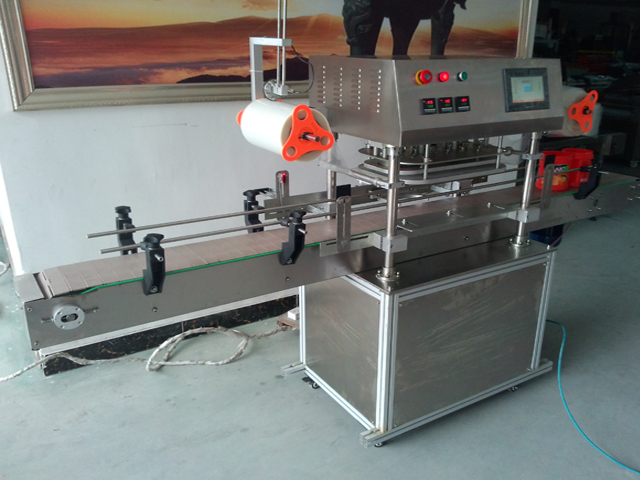 sealing machine in operation.jpg