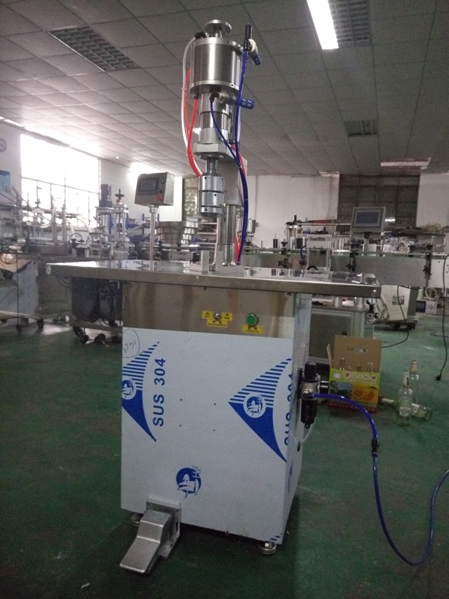 crimping machine aerosol cans.jpg