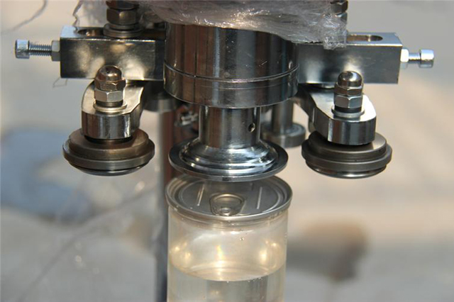 close shot for cans sealer equipment.jpg